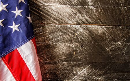beautiful starry striped flag of united states of america on dark wooden background