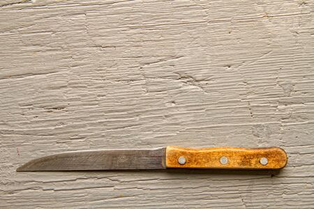 A very old kitchen knife that was grinded off from constant use on a rough wooden board