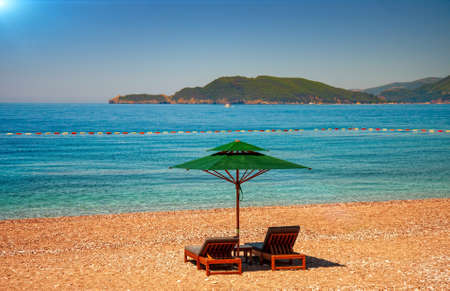 Beaches empty from quarantine and sun loungers of the tourist town of Budva in wonderful sunny weather