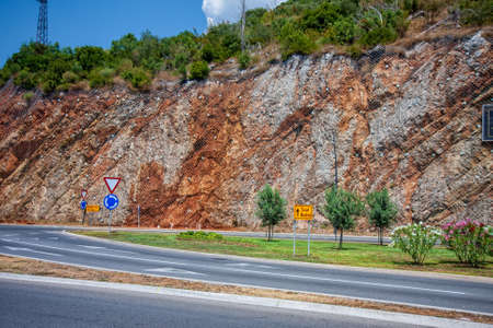 Highway in Montenegro along a mountainous section with a road sign to Tivat and Budva Foto de archivo
