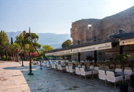 Budva - Montenegro, 1 August: Street cafes empty from quarantine and empty tables of the tourist town of Budva in wonderful sunny weather Editorial