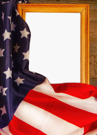 Starry striped flag of the United States of America wrapped around a wooden blank frame with space for text or photo Foto de archivo