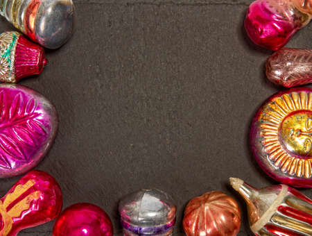 assorted glass vintage christmas tree decorations on dark surface with empty space for text