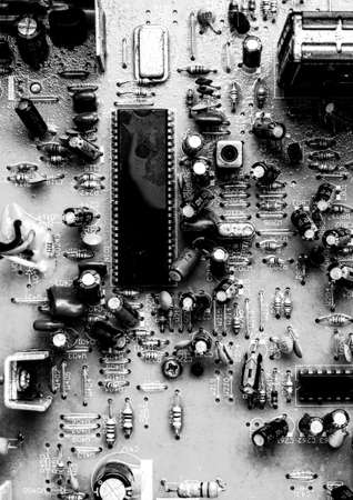 Old printed circuit board with resistors and capacitors from an analog TV close-up