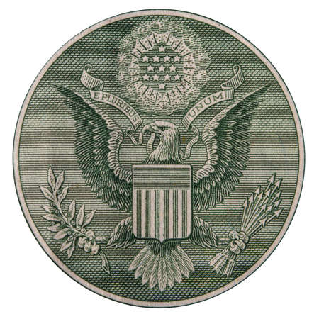 close-up of a fragment of one dollar bill with the emblem of the USA