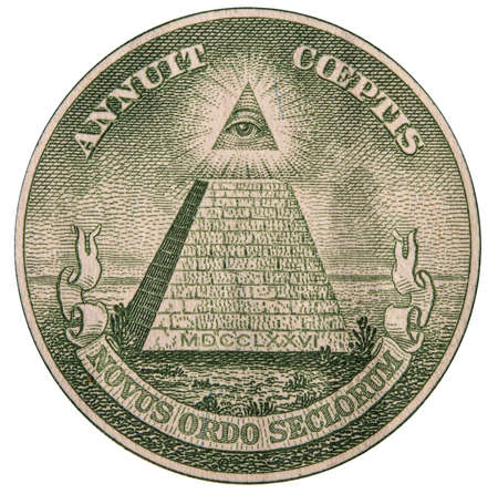close-up of a fragment of a US bank one dollar bill with a Masonic pyramid symbol and an all-seeing eye