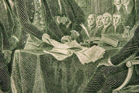 close-up image of a fragment of the Declaration of Independence on the back of a US two dollar bill