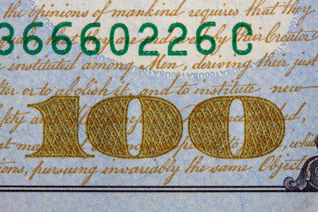 close up image of 100 denomination on a hundred dollar bill of the United States of America