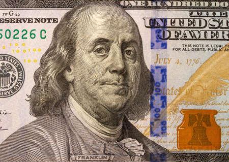close-up image of Benjamin Franklin on United States of America Hundred Dollar Bill