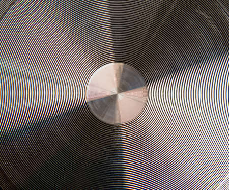 shiny metal plate with concentric annular grooves