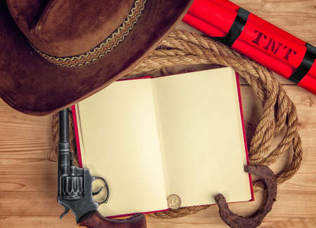 conceptual photo - open book with empty space telling about cowboys and the wild west on a wooden table