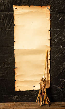 Blank manuscript with place for text and witch's broom for flying on dark background Stock Photo