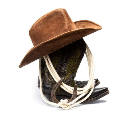 Shabby old ornate classic cowboy boots hat and lasso on white background Reklamní fotografie