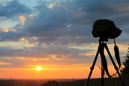 sunset in romantic landsape with photographer photo
