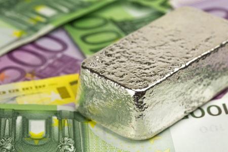 silver bullion: 1 kg silver bullion on euro banknotes Stock Photo