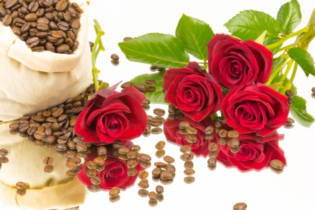 individually: Coffeebeans and roses on a mirror Stock Photo
