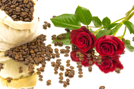 coffeebeans: Coffeebeans and roses on a mirror Stock Photo
