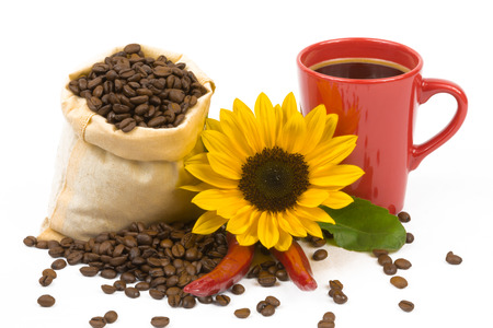 coffeebeans: A bag of coffeebeans, chillis, a cup and sunflowers