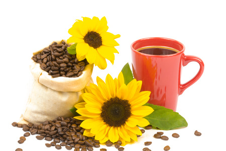 coffeebeans: A bag of coffeebeans, a cup and a sunflowers