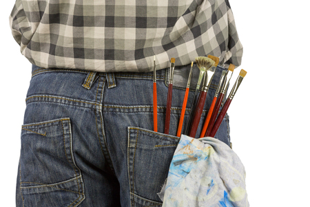 trouser: Several paintbrushes and cloths are in a trouser pocket Stock Photo