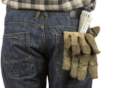 trouser: Folding rule and working gloves in a trouser pocket Stock Photo