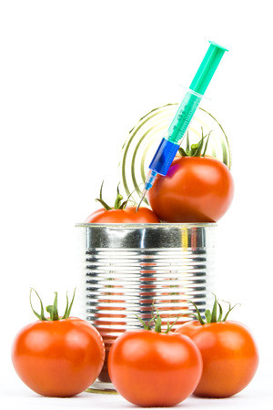 openly: Several tomatoesand a injection around a tin Stock Photo