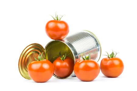openly: Several tomatoes around a tin