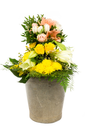 A pail with a bouquet photo