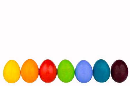 Coloured easter eggs in a row photo