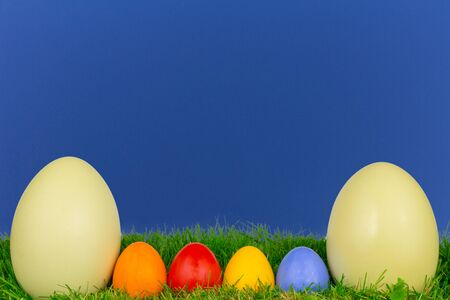Coloured easter eggs on a meadow photo