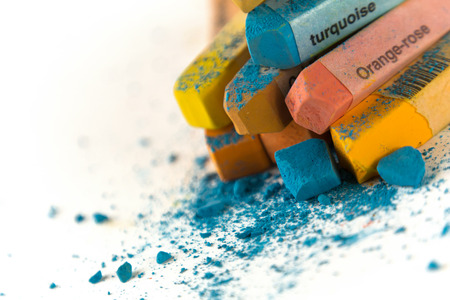 untidily: Pastel chalk pieces in different colours, uses on a heap Stock Photo