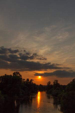 reflektion: An atmospheric sundown by the river Sieg in Rhineland