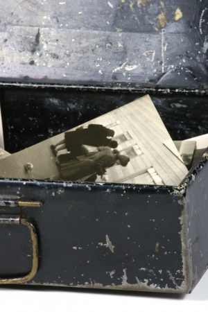 recollections: An old metal box with old photos Stock Photo