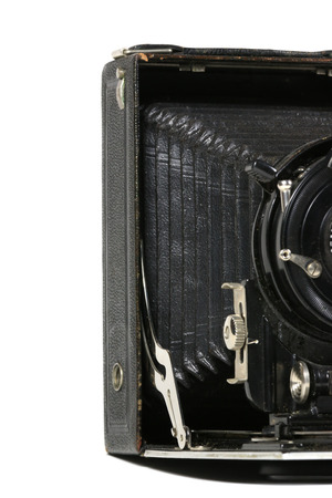 An old used record camera, bleed infront of white background photo