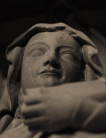 provide: Close up of a statue at night Stock Photo