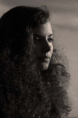 nicely: A pretty young woman´s face in the sun in b w
