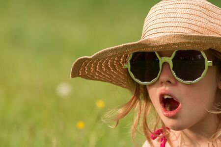 delightfully: Young girl with glasses and hat Stock Photo