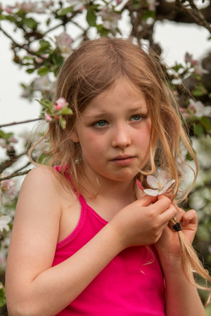 delightfully: Young girl in front of an apple tree