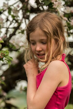 delightfully: Young girl in front of apple tree