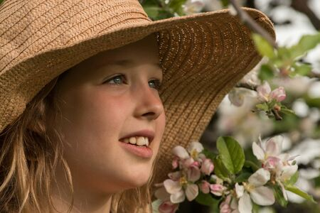 Young girl with a straw hat Stock Photo