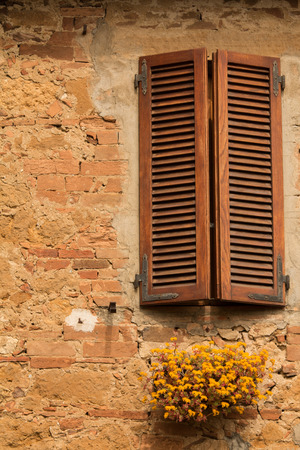 longing: window with shutters on old house