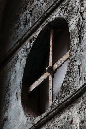 barred: Barred window in a old house