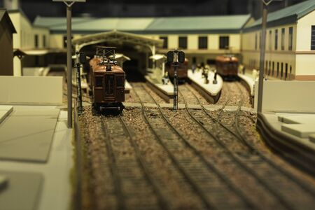 A model showing a training departing from the station