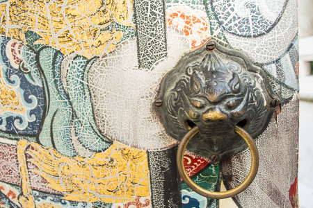 wat pho: Chinese lion knocker on the door at Wat Pho, Bangkok, Thailand.