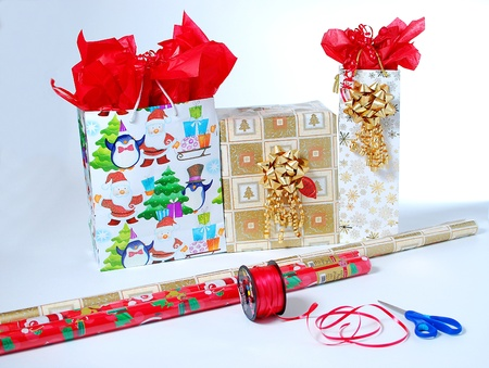 An image of several wrapped gifts with some wrapping tools photo