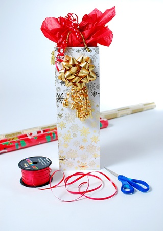 An image of a gift bag and some wrapping tools photo