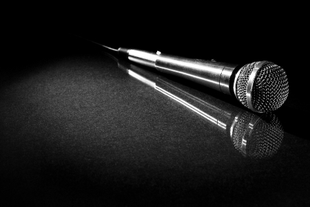 rap music: Image of microphone on reflective surface
