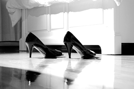 Image of high heels on bedroom floor by the bed