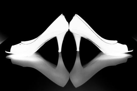 Reflected Image of High Heels Stock Photo