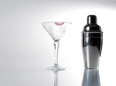 Image of martini glass with lipstick and mixer